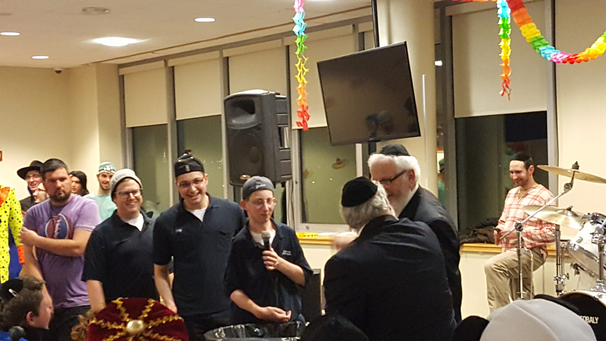 Purim Costume contest winners were Yaakov Burack, Michael Sher, and Netanel Lederer, who dressed as the Lander College for Men cleaning crew.